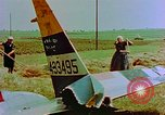 Image of German farmers work aroung a crashed U.S. Air Force P-47 in a field Germany, 1945, second 19 stock footage video 65675072706