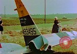 Image of German farmers work aroung a crashed U.S. Air Force P-47 in a field Germany, 1945, second 20 stock footage video 65675072706