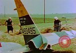 Image of German farmers work aroung a crashed U.S. Air Force P-47 in a field Germany, 1945, second 21 stock footage video 65675072706