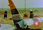 Image of German farmers work aroung a crashed U.S. Air Force P-47 in a field Germany, 1945, second 22 stock footage video 65675072706