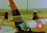 Image of German farmers work aroung a crashed U.S. Air Force P-47 in a field Germany, 1945, second 23 stock footage video 65675072706
