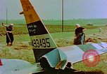 Image of German farmers work aroung a crashed U.S. Air Force P-47 in a field Germany, 1945, second 24 stock footage video 65675072706