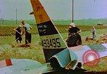 Image of German farmers work aroung a crashed U.S. Air Force P-47 in a field Germany, 1945, second 25 stock footage video 65675072706