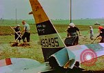 Image of German farmers work aroung a crashed U.S. Air Force P-47 in a field Germany, 1945, second 26 stock footage video 65675072706