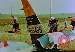 Image of German farmers work aroung a crashed U.S. Air Force P-47 in a field Germany, 1945, second 27 stock footage video 65675072706