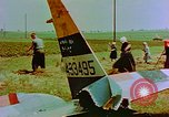 Image of German farmers work aroung a crashed U.S. Air Force P-47 in a field Germany, 1945, second 28 stock footage video 65675072706