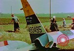 Image of German farmers work aroung a crashed U.S. Air Force P-47 in a field Germany, 1945, second 29 stock footage video 65675072706