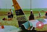 Image of German farmers work aroung a crashed U.S. Air Force P-47 in a field Germany, 1945, second 30 stock footage video 65675072706