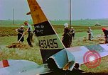 Image of German farmers work aroung a crashed U.S. Air Force P-47 in a field Germany, 1945, second 31 stock footage video 65675072706