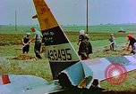 Image of German farmers work aroung a crashed U.S. Air Force P-47 in a field Germany, 1945, second 32 stock footage video 65675072706