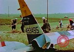 Image of German farmers work aroung a crashed U.S. Air Force P-47 in a field Germany, 1945, second 33 stock footage video 65675072706
