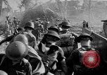 Image of allied troops invade Balikpapan Borneo Indonesia, 1945, second 62 stock footage video 65675072727
