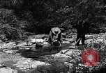 Image of gold panning Arizona United States USA, 1920, second 21 stock footage video 65675072788