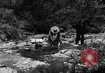 Image of gold panning Arizona United States USA, 1920, second 23 stock footage video 65675072788