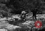 Image of gold panning Arizona United States USA, 1920, second 25 stock footage video 65675072788