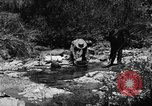 Image of gold panning Arizona United States USA, 1920, second 26 stock footage video 65675072788
