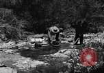Image of gold panning Arizona United States USA, 1920, second 32 stock footage video 65675072788