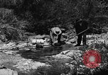 Image of gold panning Arizona United States USA, 1920, second 33 stock footage video 65675072788