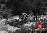 Image of gold panning Arizona United States USA, 1920, second 36 stock footage video 65675072788