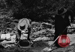Image of gold panning Arizona United States USA, 1920, second 42 stock footage video 65675072788