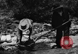 Image of gold panning Arizona United States USA, 1920, second 43 stock footage video 65675072788