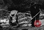 Image of gold panning Arizona United States USA, 1920, second 44 stock footage video 65675072788