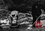 Image of gold panning Arizona United States USA, 1920, second 47 stock footage video 65675072788