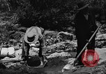 Image of gold panning Arizona United States USA, 1920, second 48 stock footage video 65675072788