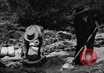 Image of gold panning Arizona United States USA, 1920, second 49 stock footage video 65675072788