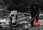 Image of gold panning Arizona United States USA, 1920, second 50 stock footage video 65675072788