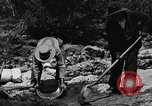 Image of gold panning Arizona United States USA, 1920, second 52 stock footage video 65675072788
