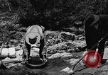 Image of gold panning Arizona United States USA, 1920, second 55 stock footage video 65675072788