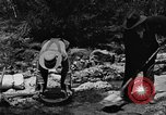 Image of gold panning Arizona United States USA, 1920, second 59 stock footage video 65675072788