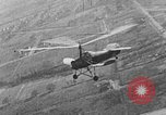 Image of Autogiro lands and takes off at a seaport United States USA, 1934, second 11 stock footage video 65675072923