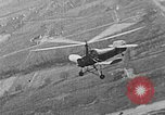 Image of Autogiro lands and takes off at a seaport United States USA, 1934, second 12 stock footage video 65675072923