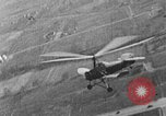 Image of Autogiro lands and takes off at a seaport United States USA, 1934, second 13 stock footage video 65675072923