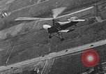 Image of Autogiro lands and takes off at a seaport United States USA, 1934, second 14 stock footage video 65675072923