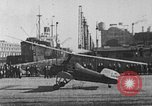 Image of Autogiro lands and takes off at a seaport United States USA, 1934, second 20 stock footage video 65675072923
