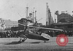 Image of Autogiro lands and takes off at a seaport United States USA, 1934, second 21 stock footage video 65675072923