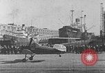 Image of Autogiro lands and takes off at a seaport United States USA, 1934, second 22 stock footage video 65675072923