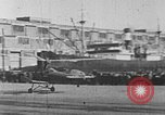 Image of Autogiro lands and takes off at a seaport United States USA, 1934, second 24 stock footage video 65675072923