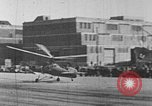 Image of Autogiro lands and takes off at a seaport United States USA, 1934, second 25 stock footage video 65675072923