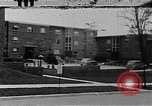 Image of apartment developments and rush hour Washington DC USA, 1949, second 15 stock footage video 65675073230