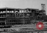 Image of school construction and suburban homes Washington DC USA, 1950, second 3 stock footage video 65675073233