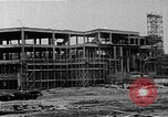 Image of school construction and suburban homes Washington DC USA, 1950, second 4 stock footage video 65675073233