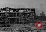 Image of school construction and suburban homes Washington DC USA, 1950, second 7 stock footage video 65675073233