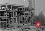 Image of school construction and suburban homes Washington DC USA, 1950, second 9 stock footage video 65675073233