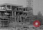 Image of school construction and suburban homes Washington DC USA, 1950, second 11 stock footage video 65675073233