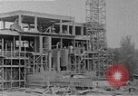 Image of school construction and suburban homes Washington DC USA, 1950, second 13 stock footage video 65675073233