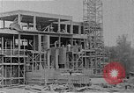 Image of school construction and suburban homes Washington DC USA, 1950, second 14 stock footage video 65675073233